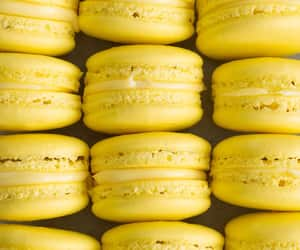 food, yellow, and ‎macarons image