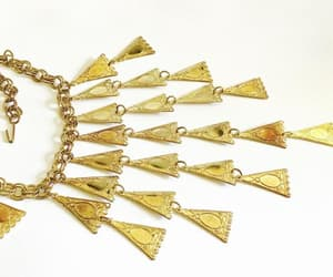 art deco, gold plated, and pressed brass bib image