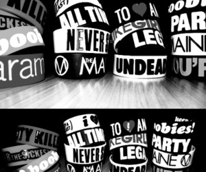 all time low, black and white, and bracelets image