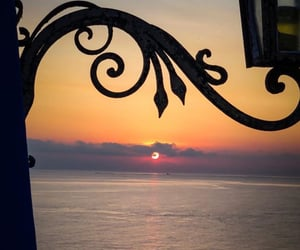 lantern, sea, and sky image