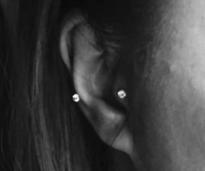 piercing, tragus piercing, and piercer image