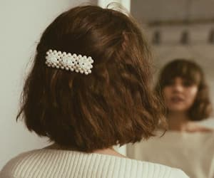 brown hair, hair accessory, and hairstyle image