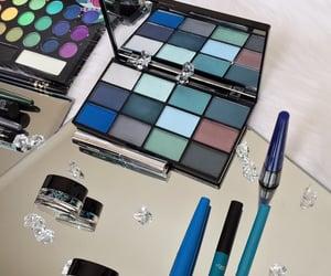 blue eyeshadow, fur rug, and gems image