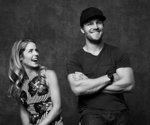 oliver queen, stephen amell, and emily bett rickards image