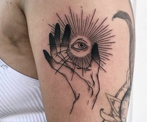 arm tattoo, tattoo, and eye tattoo image