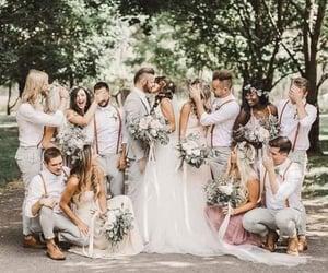 bride, bridemaids, and groom image