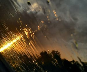 rain, sunset, and golden hour image