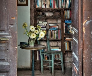 books, bookshelf, and flowers image