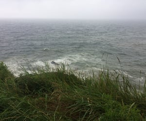 blue, cliff, and grass image