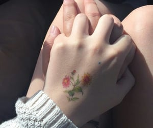 couple, hands, and flowers image