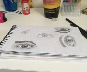 book, iris, and drawing image
