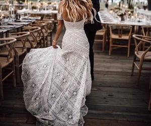 bride, groom, and dress image