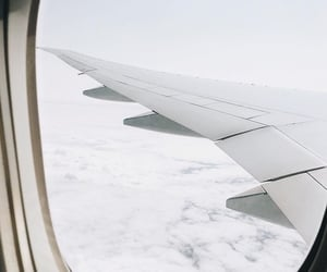 airplane, sky, and white image