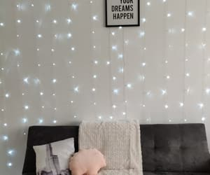 couch, cozy, and fairy lights image