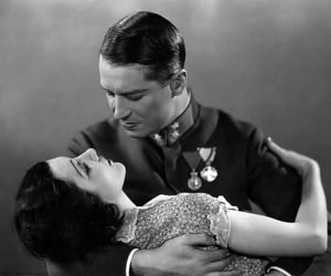 30's, claudette colbert, and Maurice Chevalier image