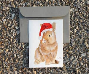 christmas card, santa claus hat, and christmas bunny image
