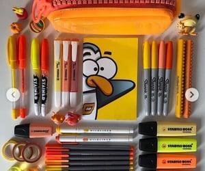 notebook, orange, and school supplies image