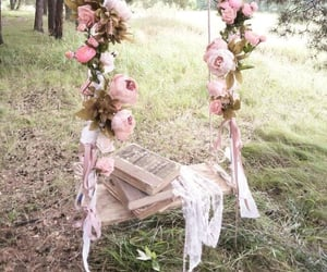 book, flowers, and swing image