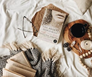 bed, blanket, and books image