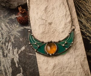 amulet, green necklace, and sister image