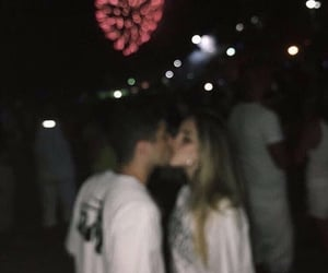 kiss, couple, and fireworks image