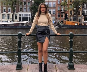 black skirt, boots, and chic image