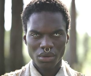 black man, unusual, and blue image