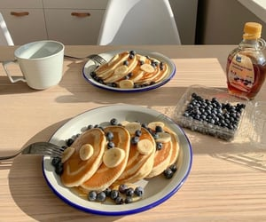 banana, blueberries, and pancakes image