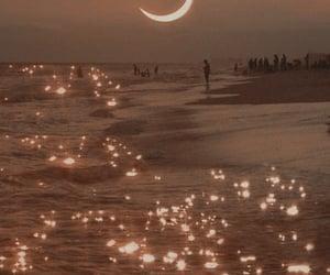 moon, beach, and sea image