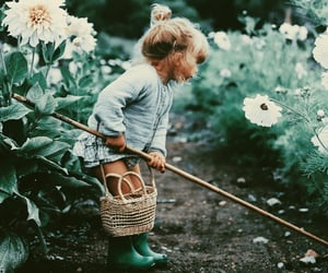 child, family, and flowers image
