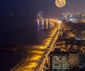full moon and barcelona-spain image