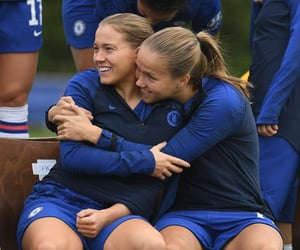 women, football, and hug image