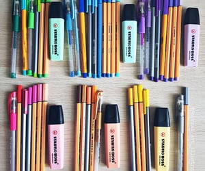 highlighter, markers, and pens image