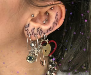 tattoo, piercing, and earrings image