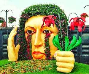 dubai miracle garden and crying lady sculpture image
