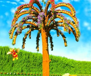 palm trees and dubai miracle garden image