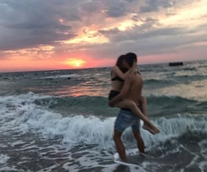 couple, kiss, and sea image