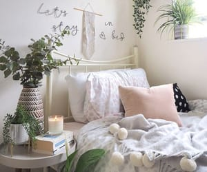 How to transform your university or college student dorm room into a stylish bedroom. Using clever storage, cosy soft furnishings and houseplants you can create a beautiful home from home while you're away at college. #studentroom #collegedorm #collegeroo