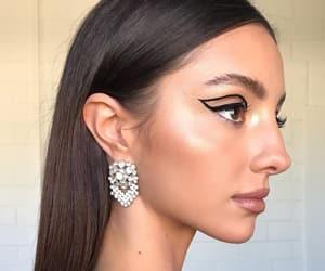 brunette, eyeliner, and jewels image