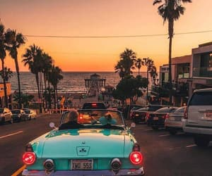 car, palm trees, and sunset image