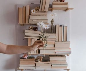books, decor, and flowers image
