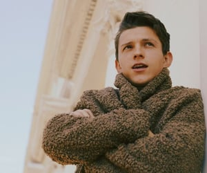 tom holland, boy, and spiderman image