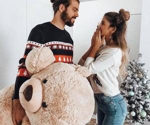 gifts, hair bun, and christmas sweater image