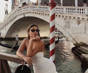 black purse, bridge, and white dress image