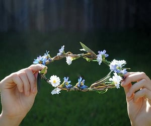 flowers, crown, and hands image