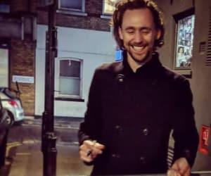smile and tom hiddleston image