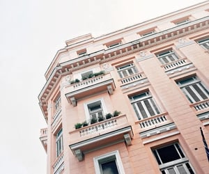 building, pink, and city image