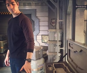 brandon routh, the atom, and ray palmer image
