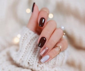 gold, nails, and sweater image