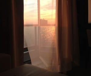 bed, sea, and sunset image